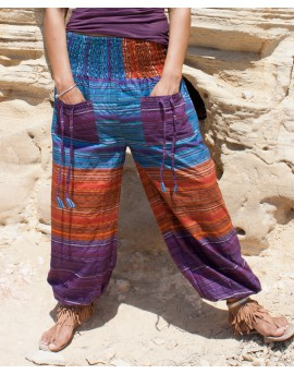 Comfy yoga and travel pants made from colourful fabric. They have elasticated panel all around ensuring perfect fit. Front view