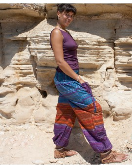 Comfy yoga and travel pants made from colourful fabric. They have elasticated panel all around ensuring perfect fit.